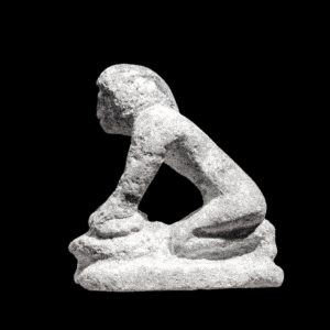 Stone figure of woman making bread